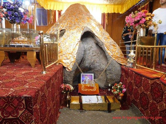 Boulder at Gurudwara Pathar Sahib with Guru Nanak's body shape inscribed on it