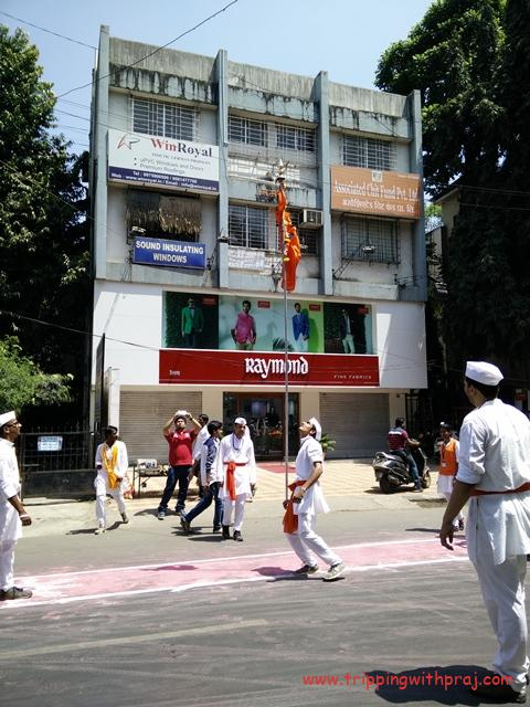 Youth joyously dancing with the traditional Bhagva (Orange coloured flag)