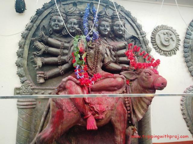 A carved statue of the Goddess Kamakhya in the temple premises