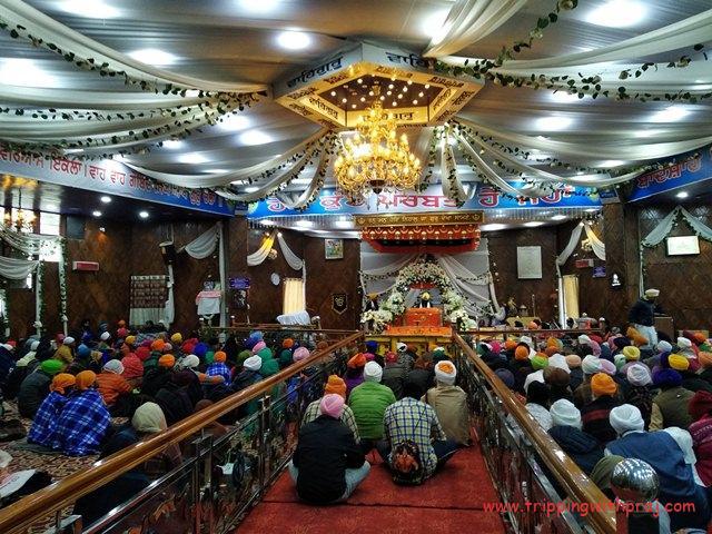Hundreds of Devotees Praying at the Gurdwara